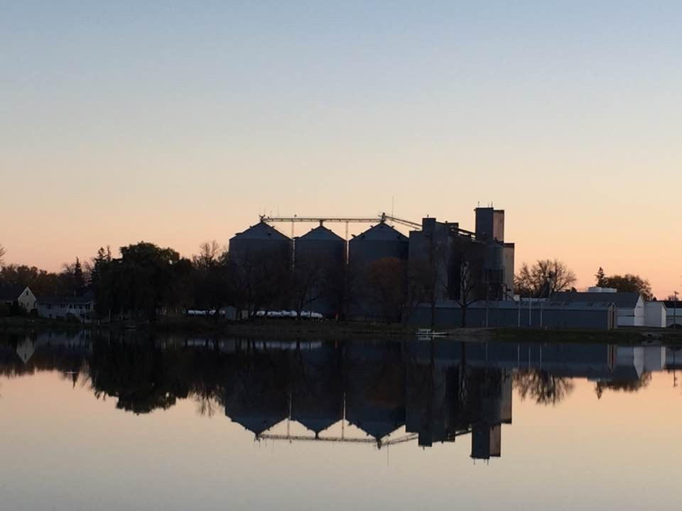 Grain elevator on lakeside at sunset